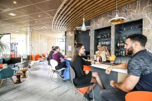A restaurant or other place to eat at ibis Paris Coeur d'Orly Airport