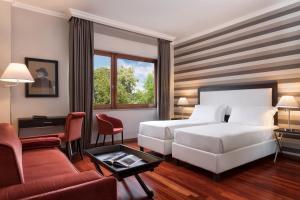 Cama o camas de una habitación en Sina Maria Luigia