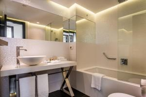 A bathroom at Alexander Boutique Hotel by the Beach