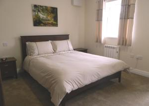 A bed or beds in a room at Lumb Farm Country Club