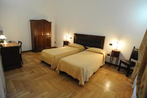 A bed or beds in a room at Residence Acropoli