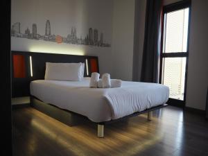 Letto o letti in una camera di easyHotel Barcelona Fira