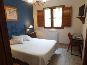 Cama o camas de una habitación en Hotel La Llosona