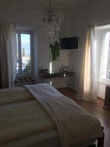 Ein Bett oder Betten in einem Zimmer der Unterkunft Pensione Olanda