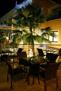 A restaurant or other place to eat at Mediterranean Beach Resort