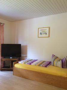 Ein Bett oder Betten in einem Zimmer der Unterkunft Ferienwohnung Baumer