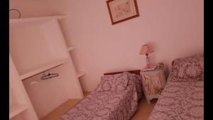 Una cama o camas en una habitación de Belgrano 1030 Junin