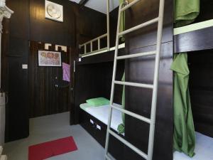Ein Etagenbett oder Etagenbetten in einem Zimmer der Unterkunft Agosto Guest House