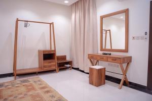 Uma TV ou centro de entretenimento em Malfakum Apartment Hotel