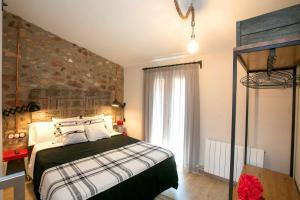 Cama o camas de una habitación en Apartaments Cal Trumfo