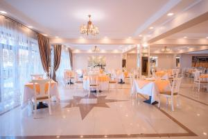 A restaurant or other place to eat at Astana International Hotel