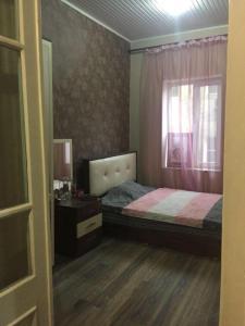 Cama ou camas em um quarto em Nizami street 95