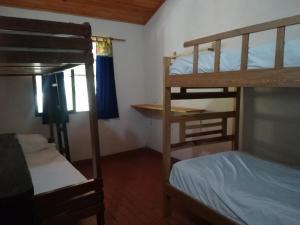 A bunk bed or bunk beds in a room at La Katia Creative Hostel