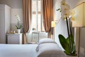 A bed or beds in a room at Hotel Rapallo