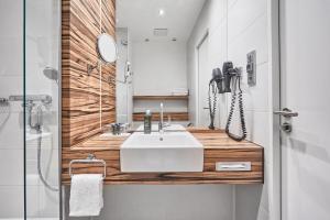 A bathroom at H4 Hotel Münster