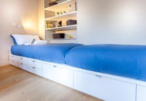 A bed or beds in a room at Greeter-Le Petit Versailles