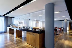 A restaurant or other place to eat at Eurostars Madrid Congress