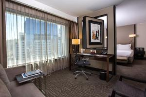 A television and/or entertainment center at DoubleTree by Hilton Santiago - Vitacura