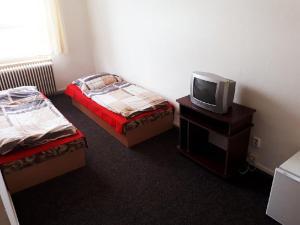 Postel nebo postele na pokoji v ubytování Ubytovna Pod Mostem