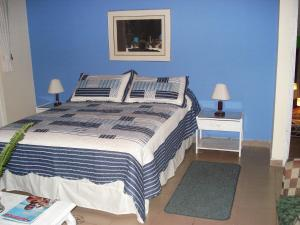 A bed or beds in a room at Miravalle Suites