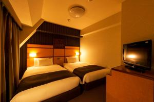 A bed or beds in a room at Hotel Villa Fontaine Tokyo-Hamamatsucho