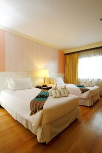 A bed or beds in a room at Princeton Bangkok