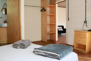 A bed or beds in a room at Coyoacan City Lofts