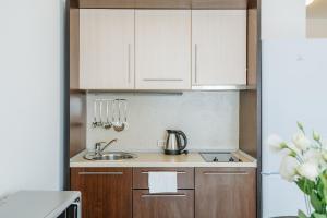Кухня или мини-кухня в Апарт-отель Имеретинский - Прибрежный квартал