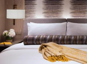 A bed or beds in a room at K11 ARTUS