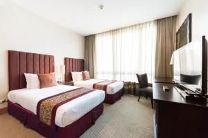 A bed or beds in a room at Ascott Sathorn Bangkok