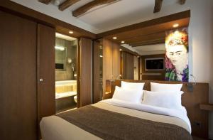 Een bed of bedden in een kamer bij Select Hotel