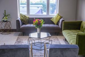 Zona de estar de Park Avenue Bayswater Inn Hyde Park