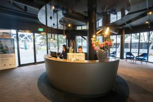 The lobby or reception area at Waterfront Melbourne Apartments