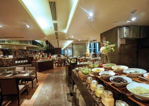 A restaurant or other place to eat at I'M Hotel