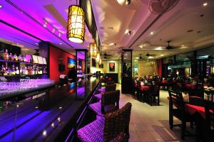 The lounge or bar area at Thipurai City Hotel