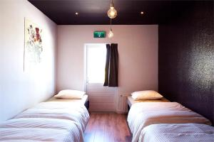 A bed or beds in a room at Su hostel