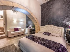 A bed or beds in a room at Martini Rooms Castello