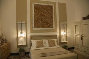 Letto o letti in una camera di Palazzo Bignami