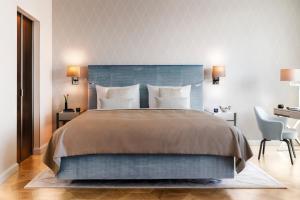 Ein Bett oder Betten in einem Zimmer der Unterkunft The Fontenay