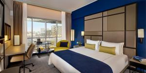 A bed or beds in a room at Park Plaza Utrecht