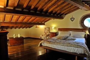 Letto o letti in una camera di Casa Vacanze Michelangelo