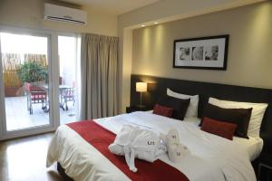 A bed or beds in a room at Urban Suites Recoleta Boutique Hotel