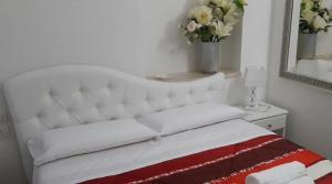 A bed or beds in a room at La Casa di Titti