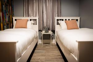 A bed or beds in a room at REM Hotel