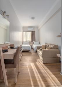 A seating area at Attalos Hotel