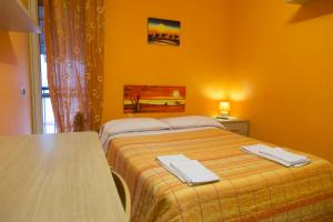 A bed or beds in a room at Campi Flegrei House