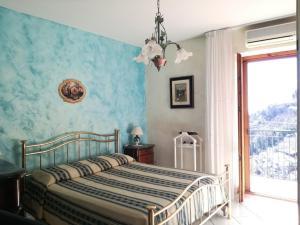 Cama ou camas em um quarto em Domus Gaia