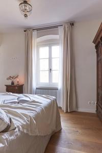 Ein Bett oder Betten in einem Zimmer der Unterkunft Castello Fai