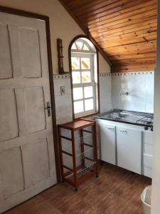 A kitchen or kitchenette at Caminho das Lavras