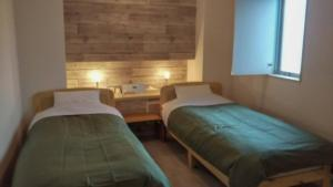 A bed or beds in a room at HOTEL Porte
